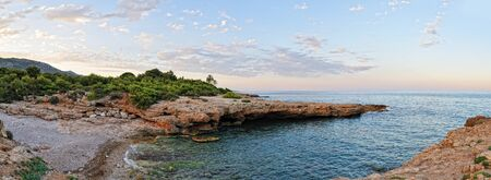 Beautiful landscape with coast of the sea. Sunset sky. Spain. Pamoramic view. photo