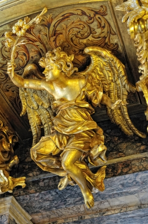Figure of the golden angel on the roof of the Catholic Cathedral. photo
