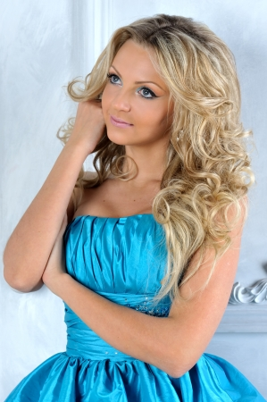 Beautiful blonde woman in a blue dress. photo