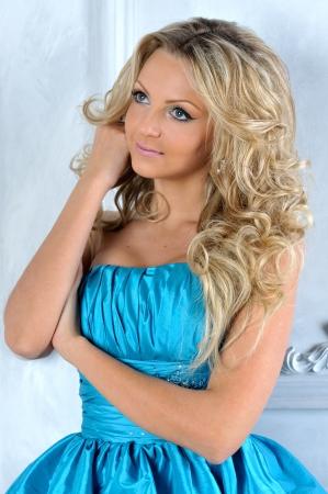 lux: Beautiful blonde woman in a blue dress.