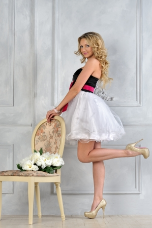 Beautiful blonde woman in fancy dress in luxury interior. Stock Photo