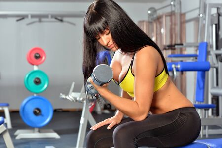 Beautiful woman doing exercises in a sport club. photo