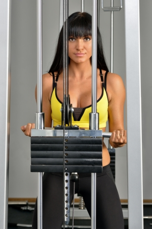 Beautiful woman doing exercises in sport club. photo