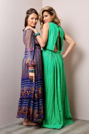Two beautiful woman in long dresses. photo