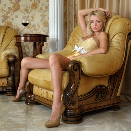 young naked girl: Beautiful woman in yellow underwear in luxury interior.