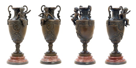 Two ornate antique bronze vases with angel figure. photo