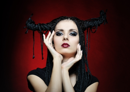 Beautiful woman in carnival costume. witch shape with Horns. Stock Photo - 15761027