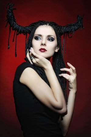 Beautiful woman in carnival costume. witch shape with Horns. photo