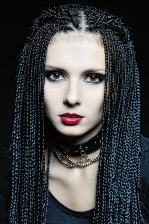 Beautiful woman in gothic shape with african pigtails . photo