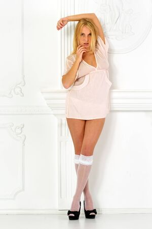 stockings woman: Beautiful blonde woman  in lingerie in white interior. Studio shooting. Stock Photo