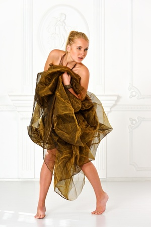 Beautiful nude woman  in drape in studio with classic antique interior. Stock Photo - 16548430