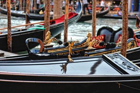 berth: Venetian gondolas at the berth  Close-up  Stock Photo