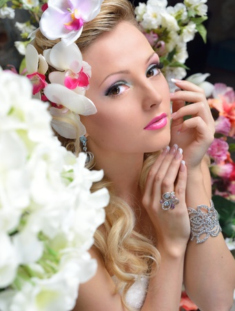 chic woman: Portrait of the beautiful chic woman around the flowers.