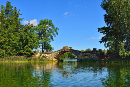 stone bridge: Summer landscape with lake and bridge in Gatchina park, Russia