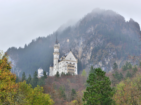 Neuschwanstein castle in Germany. View with mountains. Raining frog mood.
