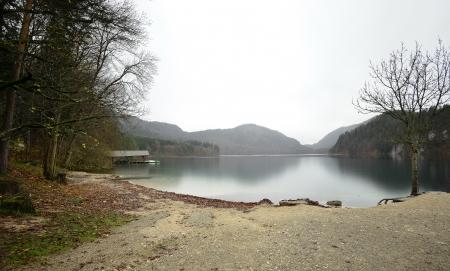 Lake near the Neuschwanstein castle in Germany. Autumn raining day. photo