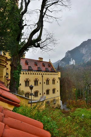 Hohenschwangau castle in Germany. View with mountains. Raining frog mood.