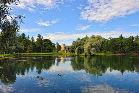 Summer Landscape in Gatchina park. View to the pond and palace.