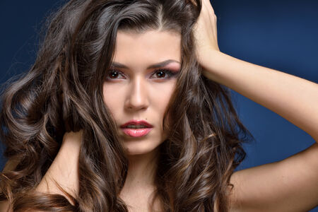 Head of the beautiful woman with long brown hair . Stock Photo