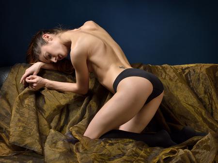 sex pose: Naked Beautiful woman in black panties posing in studio.
