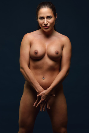 sex pose: Torso portrait of the Beautiful athletic naked woman shooted in studio.