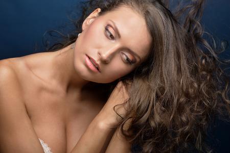 sex pose: Portrait of the beautiful woman with long hair. Torso portrait.