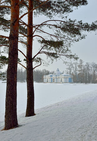 pushkin: Landscape with Grot pavillion at the lake in Catherine garden. Winter snowy view in Pushkin, Russia. Stock Photo