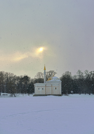 catherine: Winter  landscape with Turkish Bath  pavilion and lake in Catherine garden, Pushkin, Russia Editorial