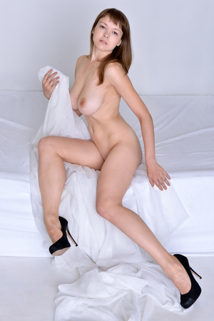 beautiful naked woman: Beautiful naked woman in a black shoes sitting on the bed