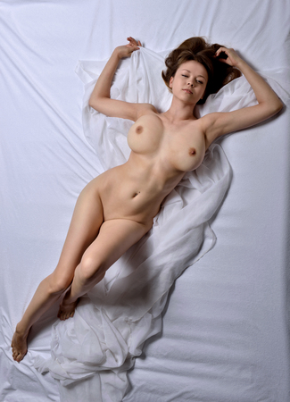 Naked beautiful woman with big breast. View from the top high angle.