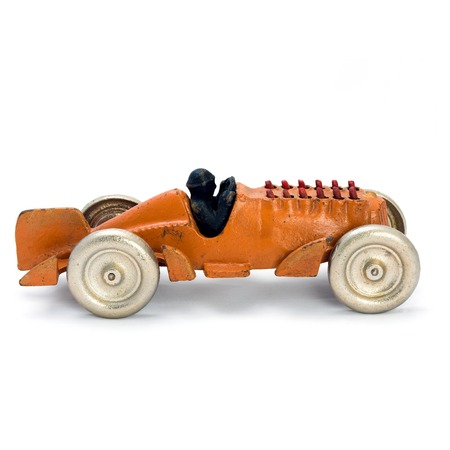 windup: Antique yellow wind-up  car. Isolated image.