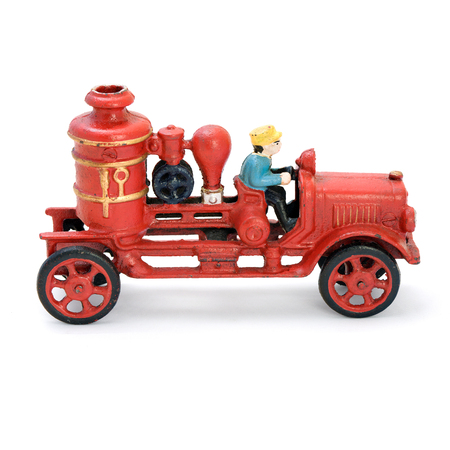 antiquity: Antique red wind-up car. Isolated image.