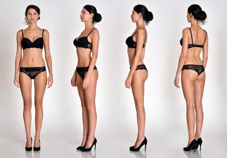 Veel vrouwen figuren volledige lengte vanuit alle hoeken in zwart ondergoed in studio met grijze achtergrond. Geen bezwaar. Stockfoto