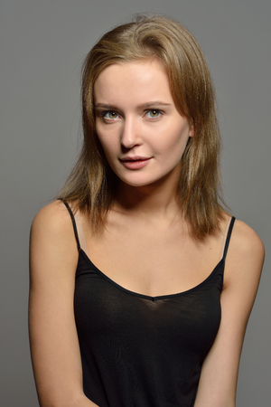 Emotional Torso Portrait of the beautiful woman  in black top. Natural make up condition. Standard-Bild