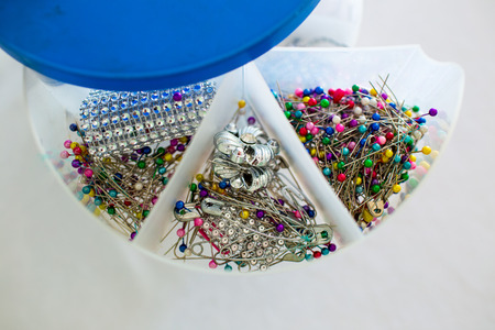 broach: pins and beads in box Stock Photo