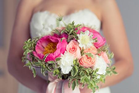 honeymooners: Close-up of bride holding bouquet