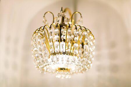 crystal chandelier: golden crystal chandelier, wall type Stock Photo