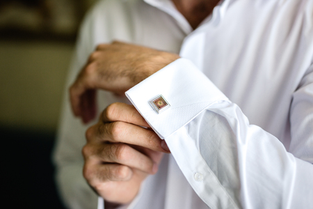 man buttons beautiful cufflinks Stock Photo