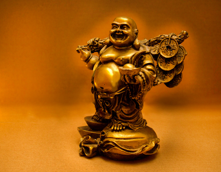 the Buddhas statue glows with golden light
