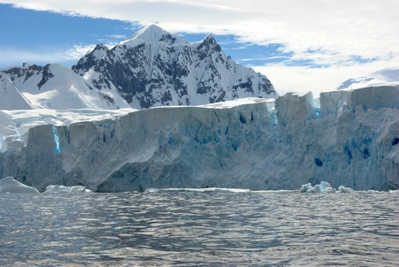 Huge iceberg in Antarctica, blue sky, azure water, sunny day. Stock Photo