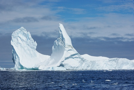 Iceberg with two vertices floating in the ocean. Stock Photo