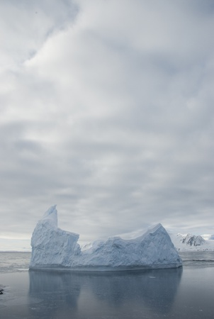 Icebergs against the overcast sky and ice. photo