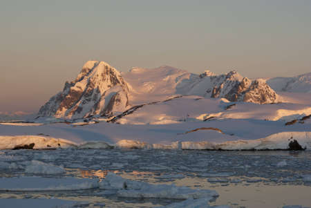 Mountain Antarctic winter at sunset. Stock Photo - 12429573