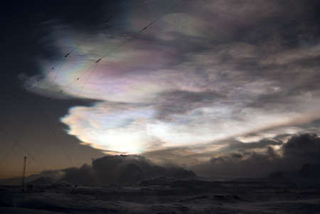 Nacreous clouds over the mountains of the Antarctic Peninsula winter's night. Stock Photo - 12753833