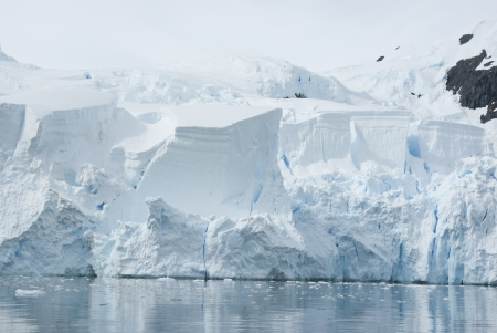 Ice sheet on the Antarctic coast summer day.