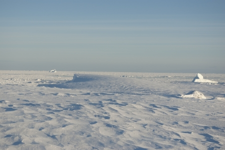 Snowy winter in the Antarctic desert day. photo