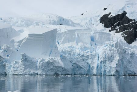 Iceberg breaks off from a glacier in the summer