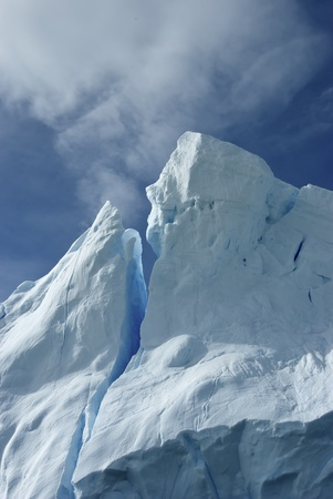 tip of the iceberg: Tip of an iceberg against a bright blue sky Antarctic summer.
