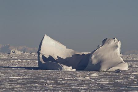 antarctic peninsula: large iceberg stuck in the Strait clogged with ice in the Antarctic Peninsula Stock Photo