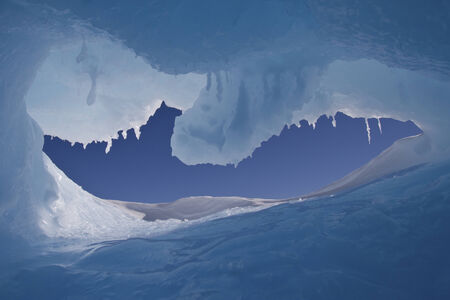 hole in an iceberg with a view of the Antarctic winter sky